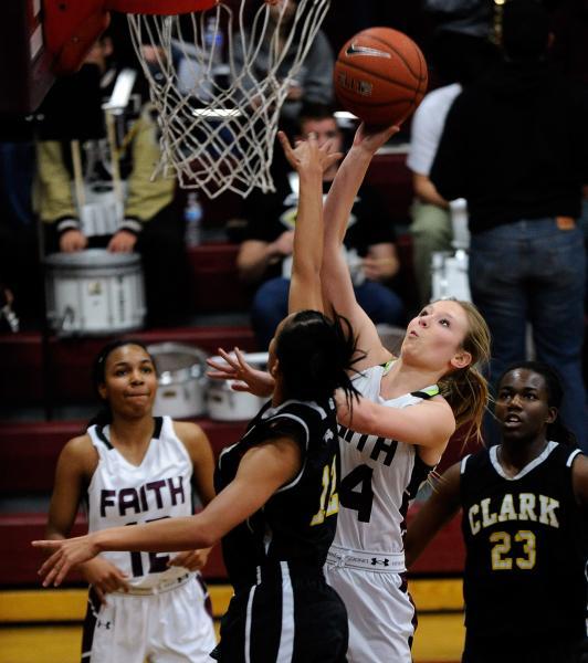 Faith Lutheran's Morgan Hill shoots against Clark's Bobbi Floyd as Faith Lutheran's Haley Vinson, left, and Clark's Shyanne Carter-Wade look on Thursday night.