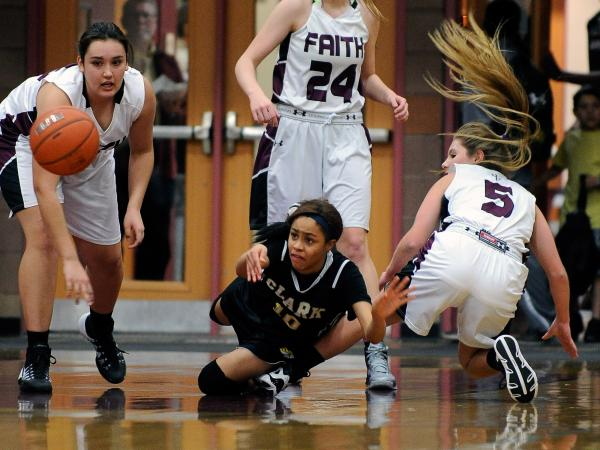 Clark's Johnice Bland (10) passes the ball as she is surrounded by Faith Lutheran's Alex Wright, left, Morgan Hill and Dani Tharaldson on Thursday.