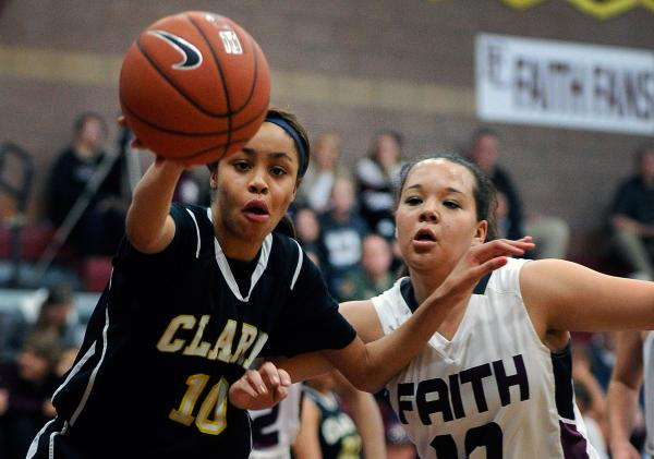 Clark's Johnice Bland, left, and Faith Lutheran's Kim Munro chase a loose ball on Thursday night.