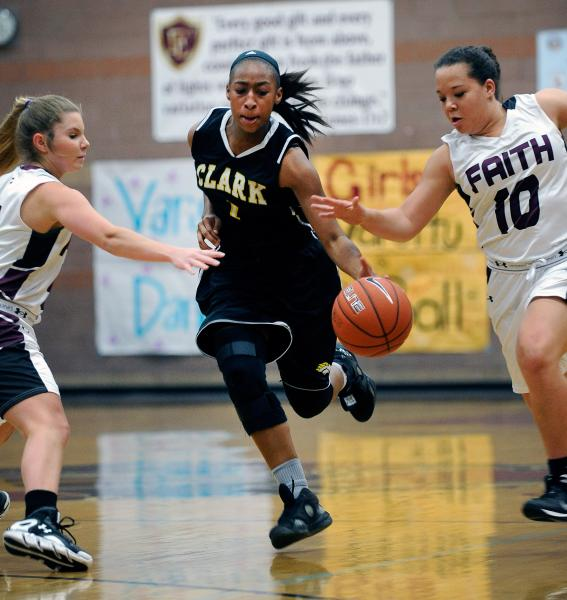 Clark's Karlicia Stroughter drives the ball down court between Faith Lutheran's Dani Tharaldson, left, and Kim Munro on Thursday.