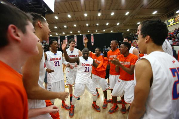 Bishop Gorman players, led by Obim Okeke (11) celebrate their 76-72 overtime win over Findlay Prep on Saturday at South Point Arena.