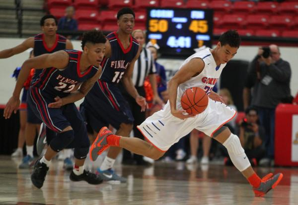 Bishop Gorman's Richie Thornton, right, tries to elude Findlay Prep's Justin Jackson (15) and Kelly Oubre (22) during Saturday's game at South Point Arena.