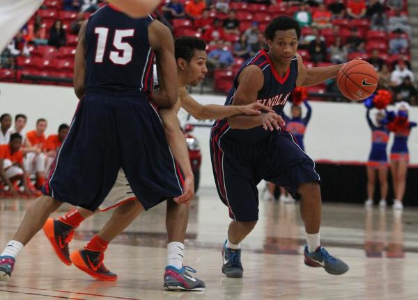 Findlay Prep's Rashad Vaughn (1) gets a pick from teammate Justin Jackson (15) and drives past Bishop Gorman's Noah Robotham during Saturday's game at South Point Arena.
