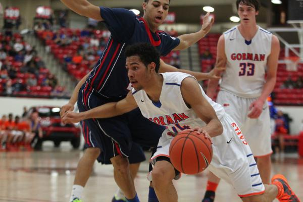 Bishop Gorman's Noah Robotham (14) pushes through Findlay Prep's Derryck Thornton (2) as Gorman's Stephen Zimmerman (33) looks on during Saturday's game at South Point Arena.