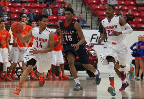 Bishop Gorman's Noah Robotham (14) looks for help from teammate Nick Blair (23) as Findlay Prep's Justin Jackson (15) defends during Saturday's game at South Point Arena.