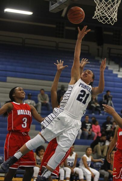 Canyon Springs' Trimece Thomas (21) scores in front of Valley's Alaihya Williams (3) on Tuesday.