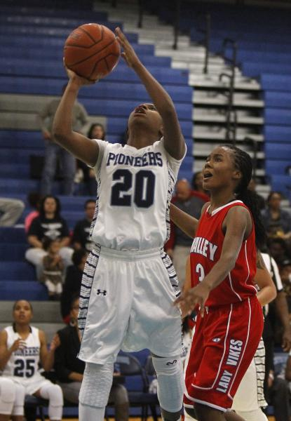 Canyon Springs' Alexia Thrower (20) shoots over Alaihya Williams (3) on Tuesday night.