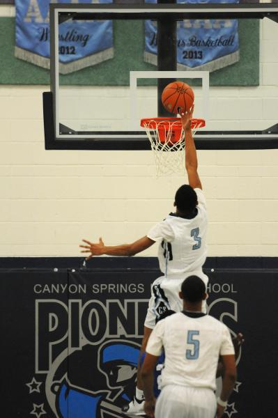 Canyon Springs' Jordan Davis goes in for a layup on Thursday against Desert Pines. Davis scored 20 points as the Pioneers rallied for a 66-61 home win.