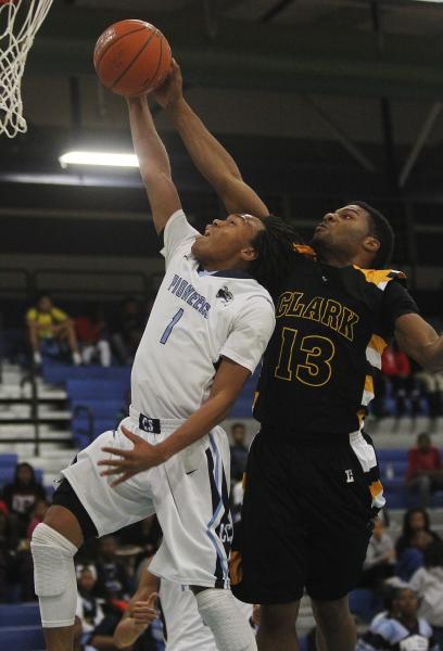 Clark's Ty'Rek Wells (13) blocks the shot of Canyon Springs' Chris Nelson (1) on Friday.