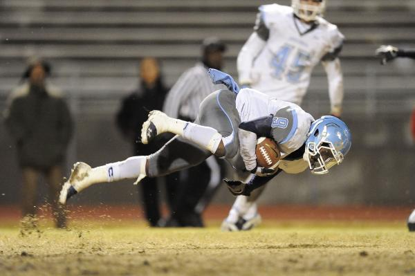 Centennial's Gene Haley loses his balance while returning a kick.