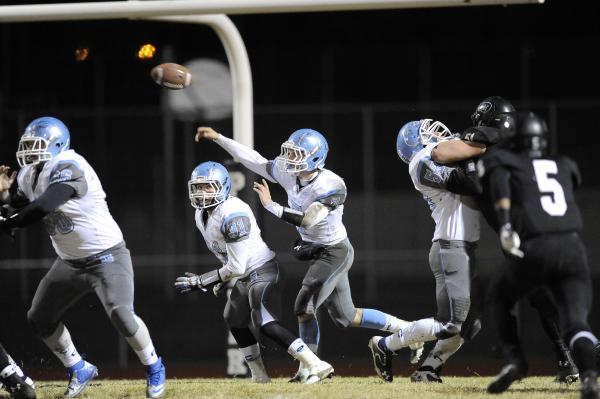 Centennial quarterback Coll Thomson (7) throws a pass