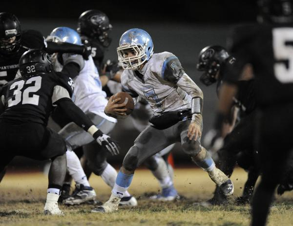 Centennial's Coll Thomson (7) looks for room against Palo Verde's Chauntez Thomas (32).