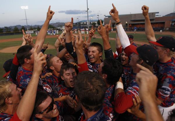 Coronado players celebrate following their 7-4 win over Bishop Gorman in the Division I state title game on Saturday. Coronado beat the Gaels twice Saturday to end Gorman's streak of seven consecu ...