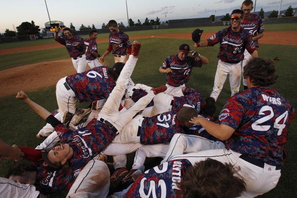 Coronado players celebrate after beating Bishop Gorman 7-4 in the Division I state baseball final at College of Southern Nevada on Saturday.