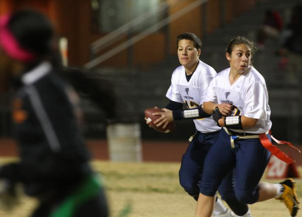 Foothill quarterback Sam Fennell (13) rolls to her right in a game with Chaparral on Wednesday.