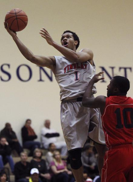Findlay Prep's Rashad Vaughn (1) soars to the basket past Planet Athlete's Reginald Norris (10).