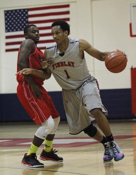 Findlay Prep's Rashad Vaughn (1) drives past Planet Athlete's Reginald Norris (10).