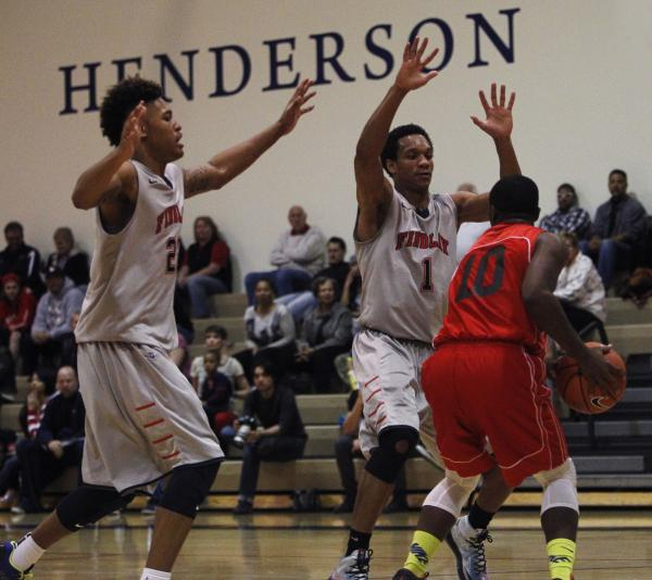 Findlay Prep's Rashad Vaughn (1) and Kelly Oubre Jr. (22) attempt to trap Planet Athlete's Reginald Norris (10).