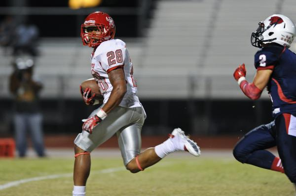 Arbor View running back Jacob Speaks (28) looks back at Coronado defender Wade Jacobs (2) during a TD run on Friday.