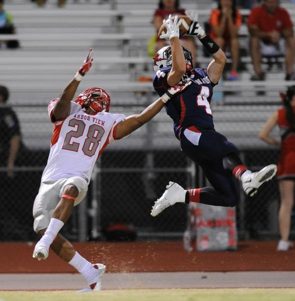 Coronado receiver Michael Simpson (4) tries to make a leaping catch over Arbor View defender Jacob Speaks (28) on Friday.