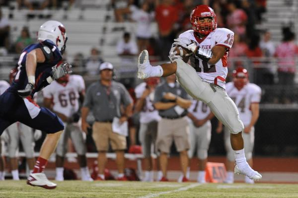 Arbor View running back Devon Turner (12) catches a pass in front of Coronado defender Koy Harris (1) on Friday. The Aggies topped the Cougars, 42-0.