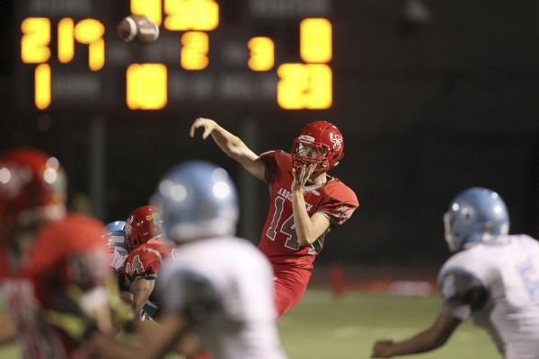 Arbor View quarterback Andrew Cornwell throws a pass against Centennial on Thursday. Cornwell didn't complete a pass, but the Aggies still rolled to a 35-8 home win.
