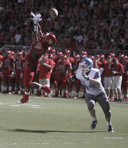 Arbor View running back Devon Turner leaps to try to catch a pass as Centennial's Hunter Brown defends. The Aggies didn't complete a pass, but still rolled to a 35-8 home win.