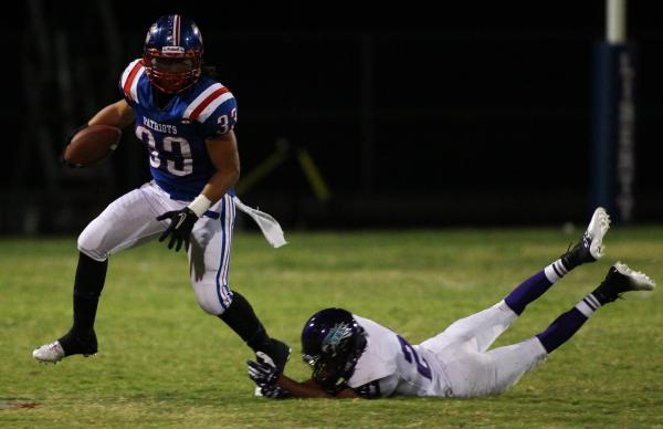 Liberty's Brenan Adams (33) eludes Silverado's Daniel Savage (21) during the Patriots' 35-8 win on Saturday.