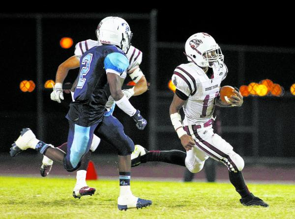 Desert Oasis running back Jocquez Kalili, racing past Canyon Springs safety Raequan Bascombe (2) in the Pioneers' 30-7 win on Sept. 27, was selected the Offensive Most Valuable Player in the Sou ...
