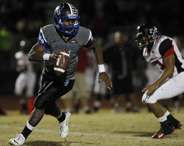 Basic quarterback Antraye Johnson (5) breaks free against Las Vegas on Friday night. Johnson rushed for 132 yards and two TDs and passed for another score.