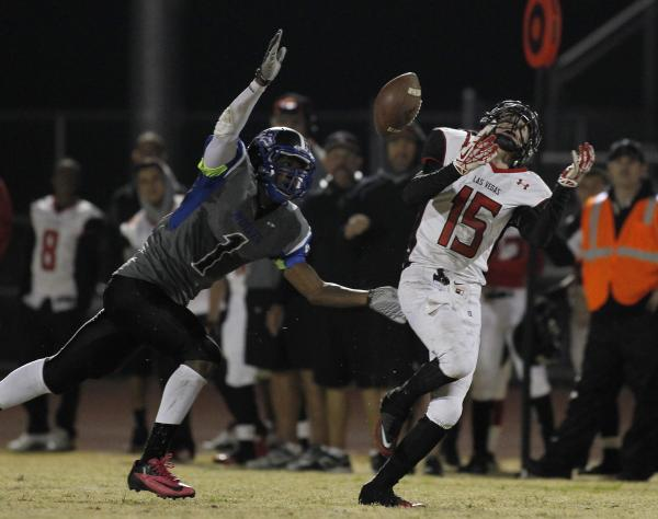 Las Vegas' Sam Blackburn (15) has a pass bounce off his shoulder pads while being covered by Basic's Demetrius Trim (1) on Friday. Blackburn hauled in seven passes for 69 yards.