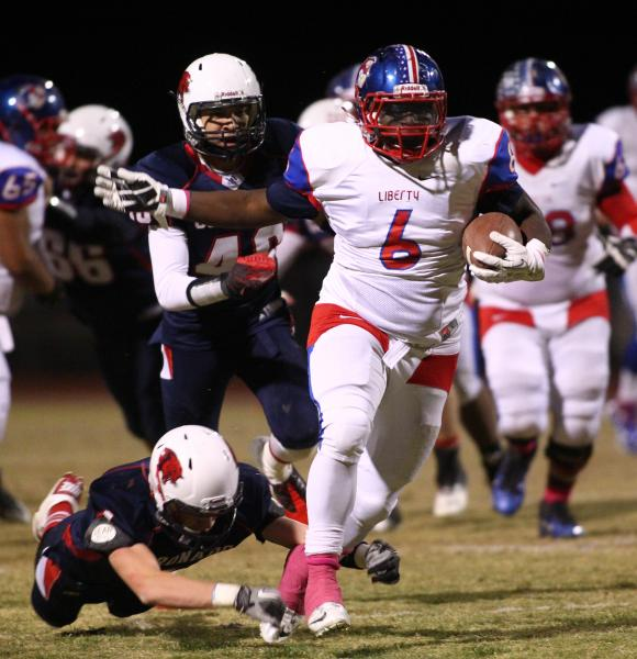 Liberty's Calvin Tubbs (6) runs through the Coronado defense on Friday. Tubbs rushed for 75 yards in a 45-27 win.