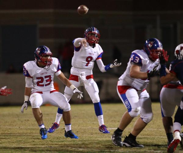Liberty quarterback Tyler Newman, seen throwing a pass against Coronado, leads the area with 3,108 passing yards and 35 TDs. The Patriots have moved from a run-heavy offense to one that features m ...
