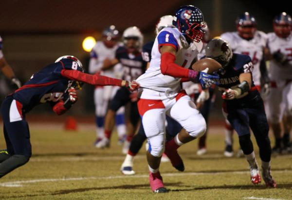 Liberty's Stephon Sowers (1) powers past a Coronado defender on Friday.