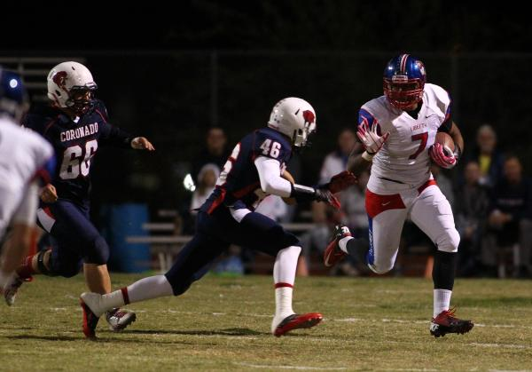 Liberty's Jarvis Polu, seen after making a catch against Coronado in the fall, signed with Navy on Wednesday.