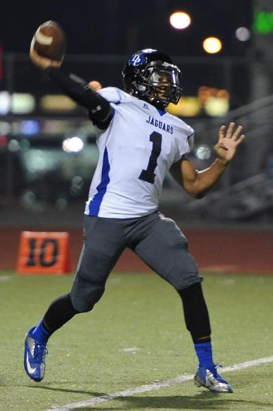 Desert Pines quarterback Iquan Corsey (1) throws a pass on Thursday at Valley. Corsey tossed three TD passes in a 45-14 win.