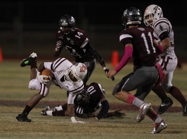 Desert Oasis running back Jocquez Kalili breaks a tackle on Friday at Cimarron-Memorial. The Spartans held Kalili, who entered the game as the area's top Division I rusher, to 89 yards on 19 carries.