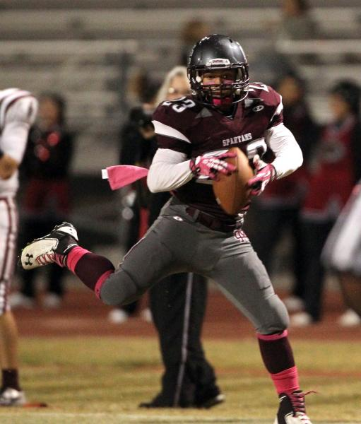 Cimarron-Memorial wide receiver Djon Watson catches a pass in the third quarter against Desert Oasis on Friday.