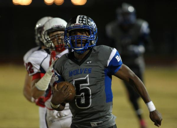 Basic's Antraye Johnson gets past Coronado to score a touchdown in the fall. Johnson was a dynamic offensive weapon, but recruiters are waiting on his SAT scores before making scholarship offers.