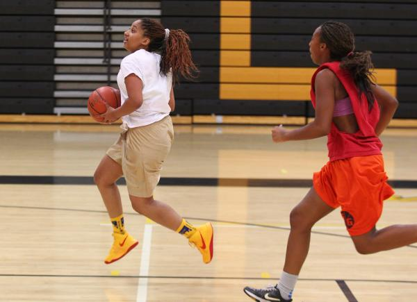 Clark senior Bre Belsar drives the ball against sophomore Karlicia Stroughter during practice.