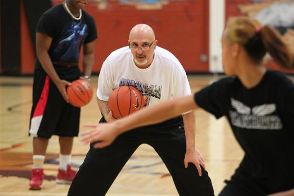 Clark girls basketball head coach Mike Moulchin leads practice on Monday.