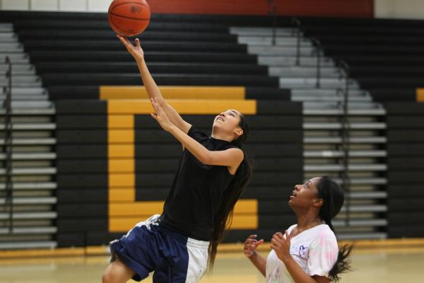 Clark sophomore Jenny Vasquez drives to the basket during a recent practice.