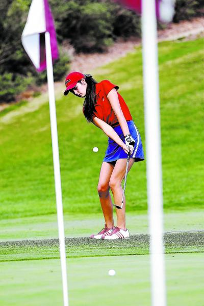 Coronado junior Natalie Yamamoto works on her short game at a recent practice. Yamamoto finished fourth at last years's Division I state tournament.