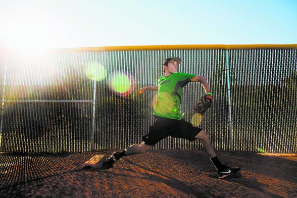 Palo Verde pitcher Michael Spada throws in the bullpen at the school. Spada recently committed to play at Holy Cross.