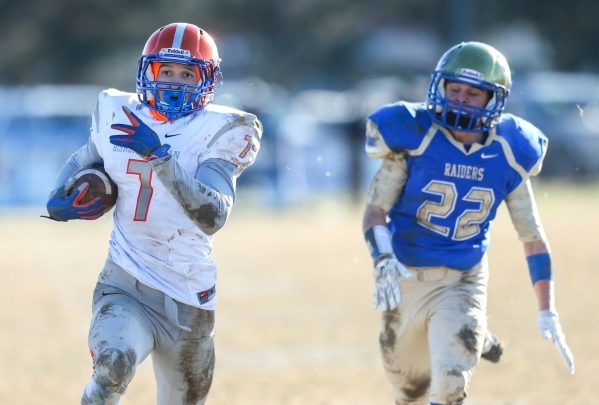 Bishop Gorman's Biaggio Ali Walsh (7) rushes for a touchdown against Reed defender Logan Marcantonio in an NIAA Division I playoff game at Reed High School in Sparks, Nev., on Saturday, Nov. ...