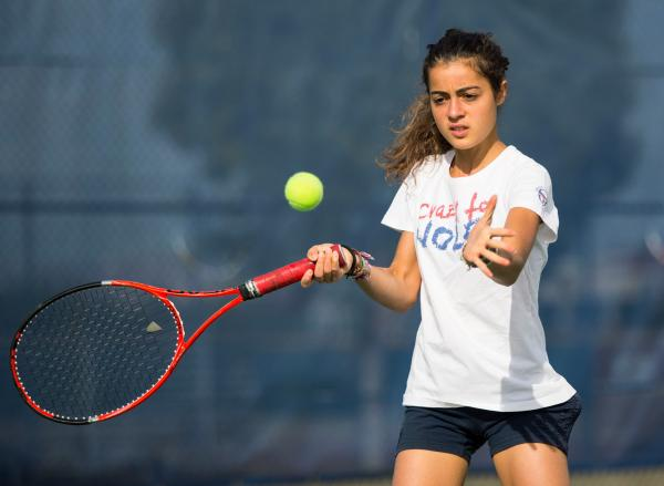 Coronado senior Roberta Padalino, a foreign exchange student from Italy, practices Wednesday ahead of the Cougars' Division I state semifinal against Bishop Gorman today at Darling Tennis Center ...