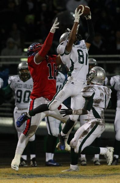 Green Valley's Kyle Parker (81) leaps to intercept a pass intended for Liberty's Noah Jefferson (18).