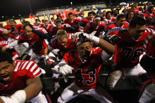 Liberty players do a celebratory haka after the game.