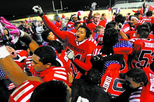 Liberty players celebrate after their win over Green Valley in the Sunrise Region final.