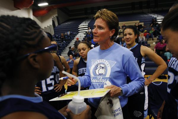 Centennial girls basketball coach Karen Weitz makes her point during a timeout of her team's game against Shadow Ridge.